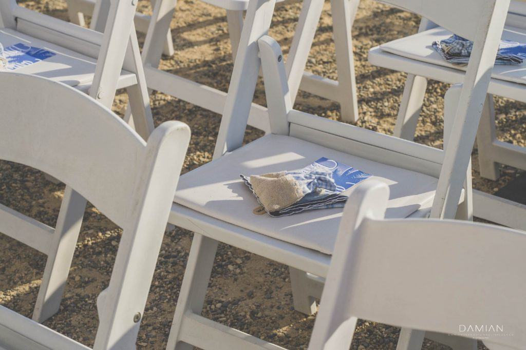 Guest chairs at the beach for ceremony
